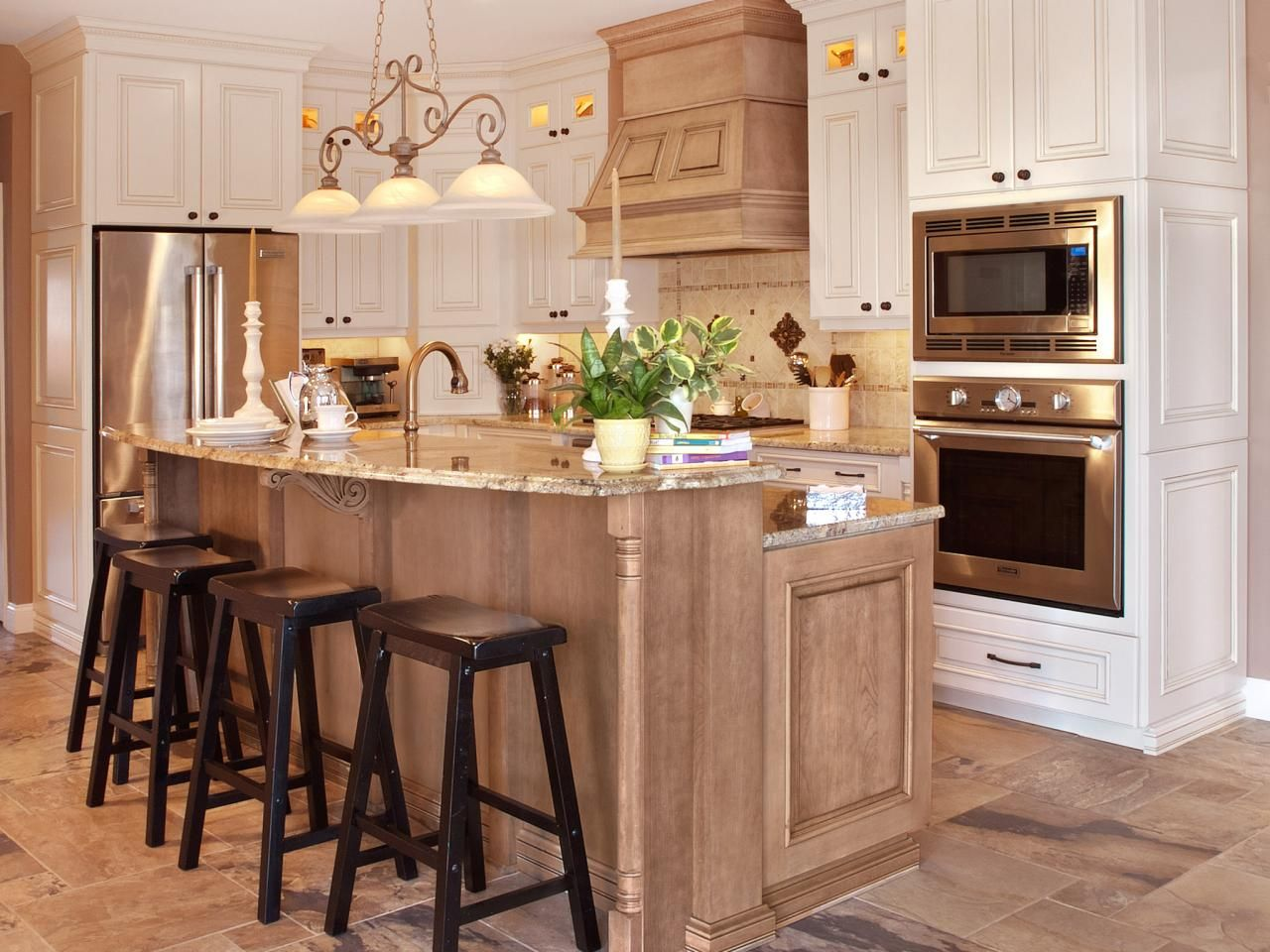 four black barstools at the kitchen island provide a great place