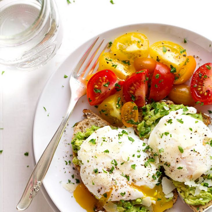 Simple Poached Egg and Avocado Toast - Easy & Simple, eggs, whole grain bread, avocado, shaved parmesan cheese, salt, pepper, fresh herbs, heirloom tomatoes