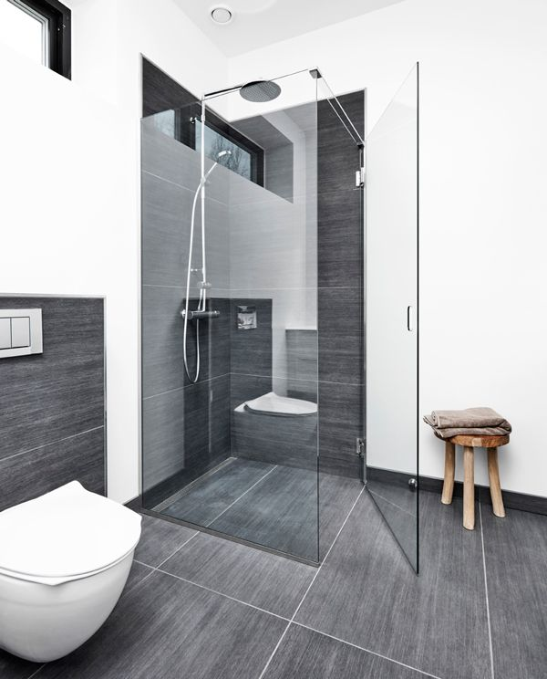 Elegant nordic bathroom with a beautiful glass shower screen. No visible screws or fittings. Unidrain® GlassLine