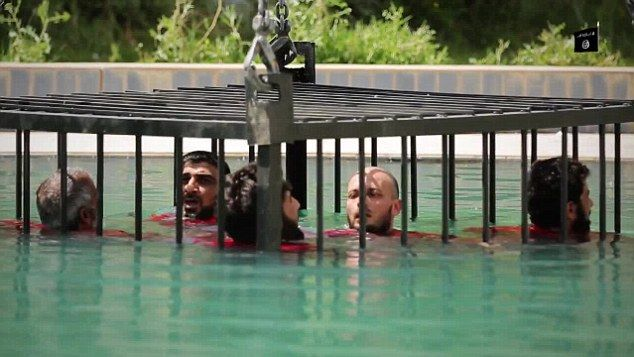 ISIS video shows caged prisoners drowned in a swimming pool