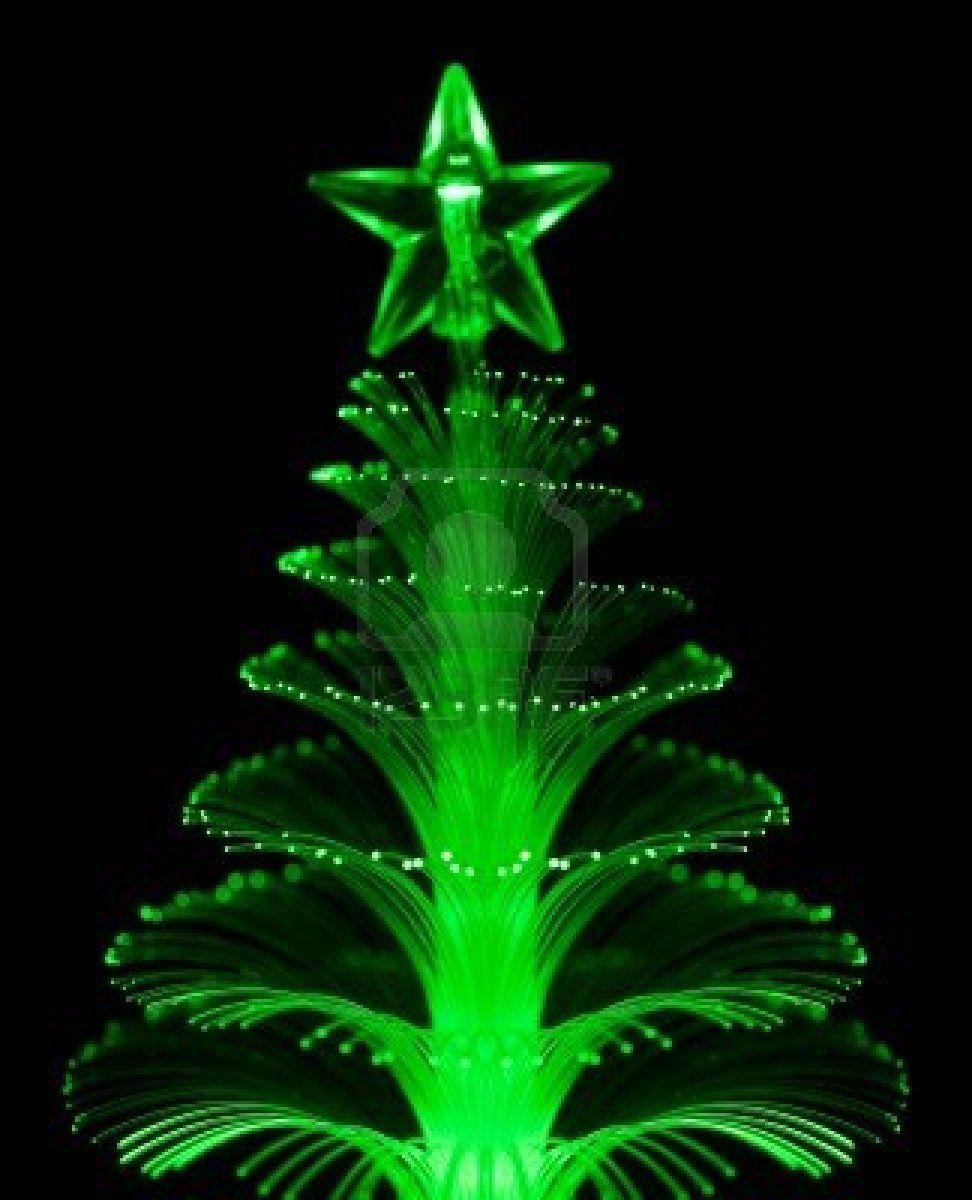 Green fiber optic Christmas tree light on black background ...