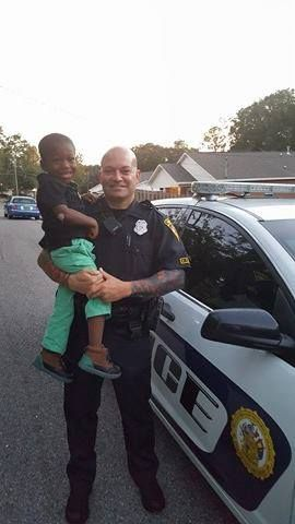 "We first introduced you to Elijah Clausell riding his three-wheel cruiser, while he patrolled his neighborhood. ""You have to put your hands behind your back,"" Elijah said. Police Story, Sheep Dogs, Law Enforcement Officer, Touching Stories, Four Year Old, Boy Meets, Above And Beyond, Fuzz, Police Officer"