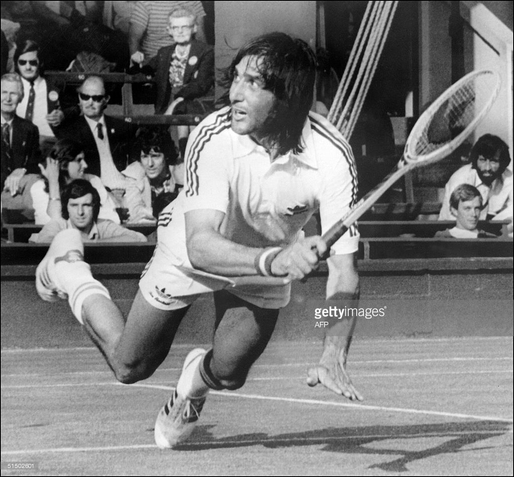 Romanian Ilie Nastase is about to fall during his match against