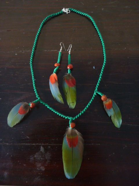 Jurema Amulet and earrings. This amulet with protective function is consecrated to the entity of the forest called Cabocla Jurema, the herbalist and hunter of the forest, the one who knows the remedies and medicinal plants to cleanse negative energies. The parrot feathers, especially green ones, are sacred to Jurema and she is used to adorn herself with them. www.facebook.com/MotherofWater