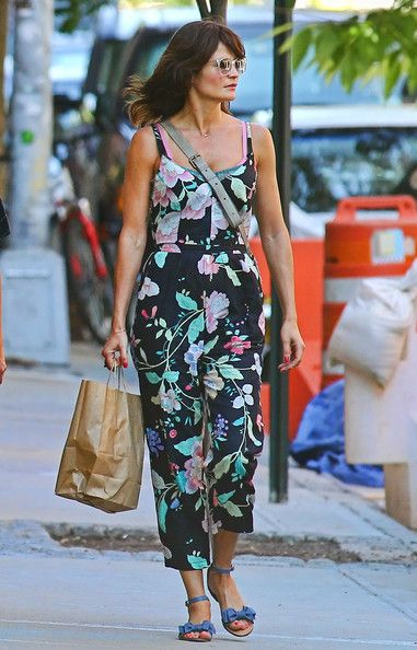 Helena Christensen Jumpsuit  Helena Christensen looked sweetly spring in this floral capri jumpsuit.   Helena Christensen Flat Sandals  Helena Christensen stepped out for an afternoon of shopping wearing a pair of blue sandals with bow details
