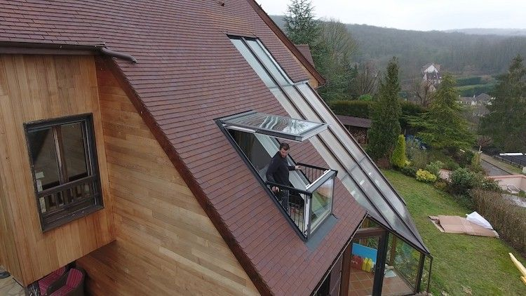 A Cleverly Designed Skylight That Turns Into A Balcony Roof Window Skylight Balcony Design