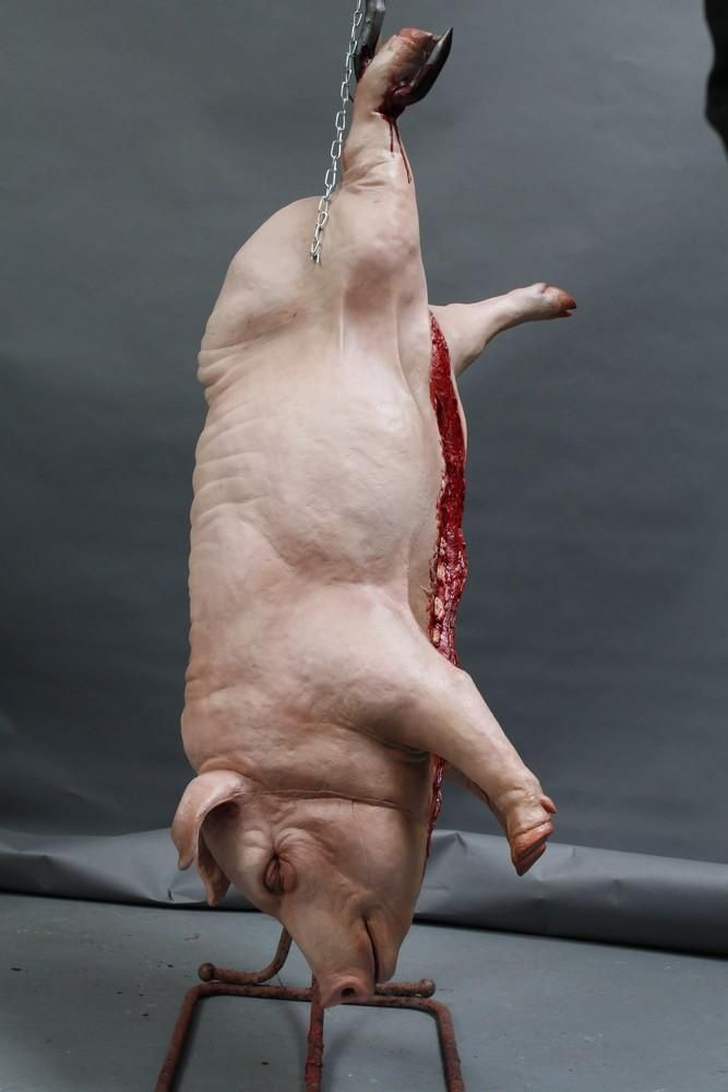 Image result for gutting a pig gif