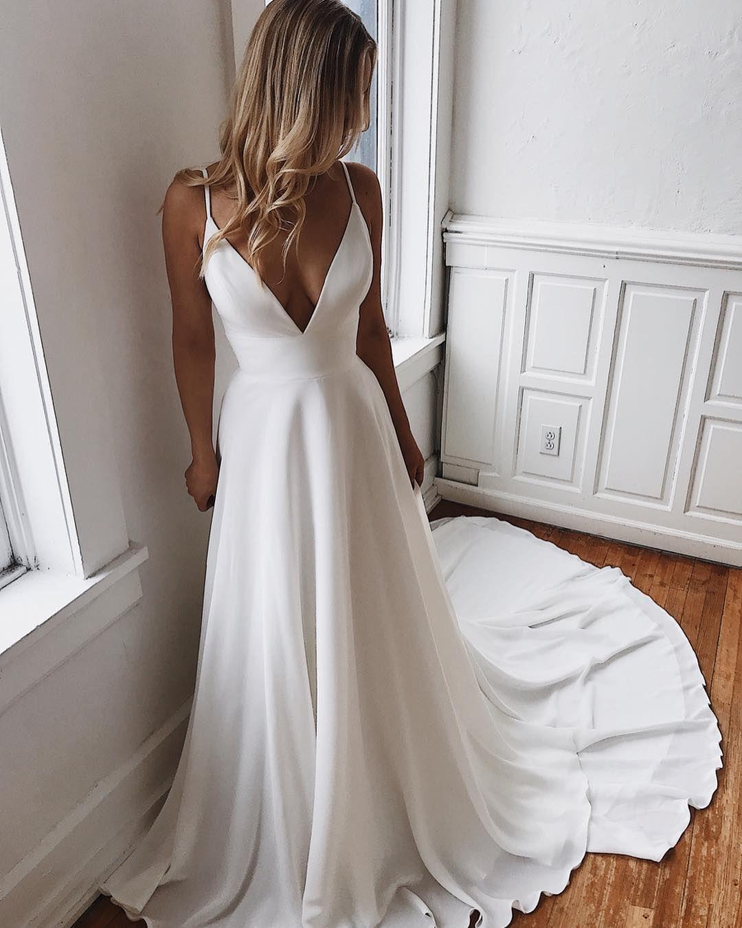 8d1a3e365cf6 gorgeous classic, modern satin v neck spaghetti strap a-line wedding dress.  beautiful train
