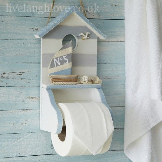 Nautical Wooden Toilet Roll Holder That Comes In A Whitewash And Distressed Pale Grey Blue Design It Has Sail Boat Seagull Shell Decoration