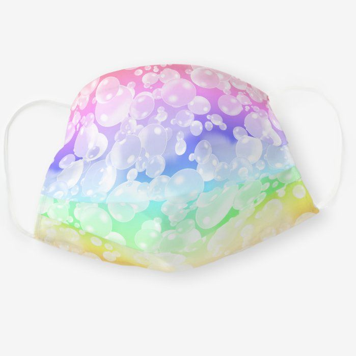 A cute design pattern featuring lots of colorful soap bubbles on bright fading rainbow background.