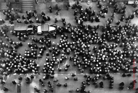 Hats in the Garment District by Margaret Bourke-White  I like the way the photographer took this picture. He took picture at the rooftop of a building. All people are wearing hats, and it makes a type of pattern. But, I don't the cars are parking on the street. These are bother me.