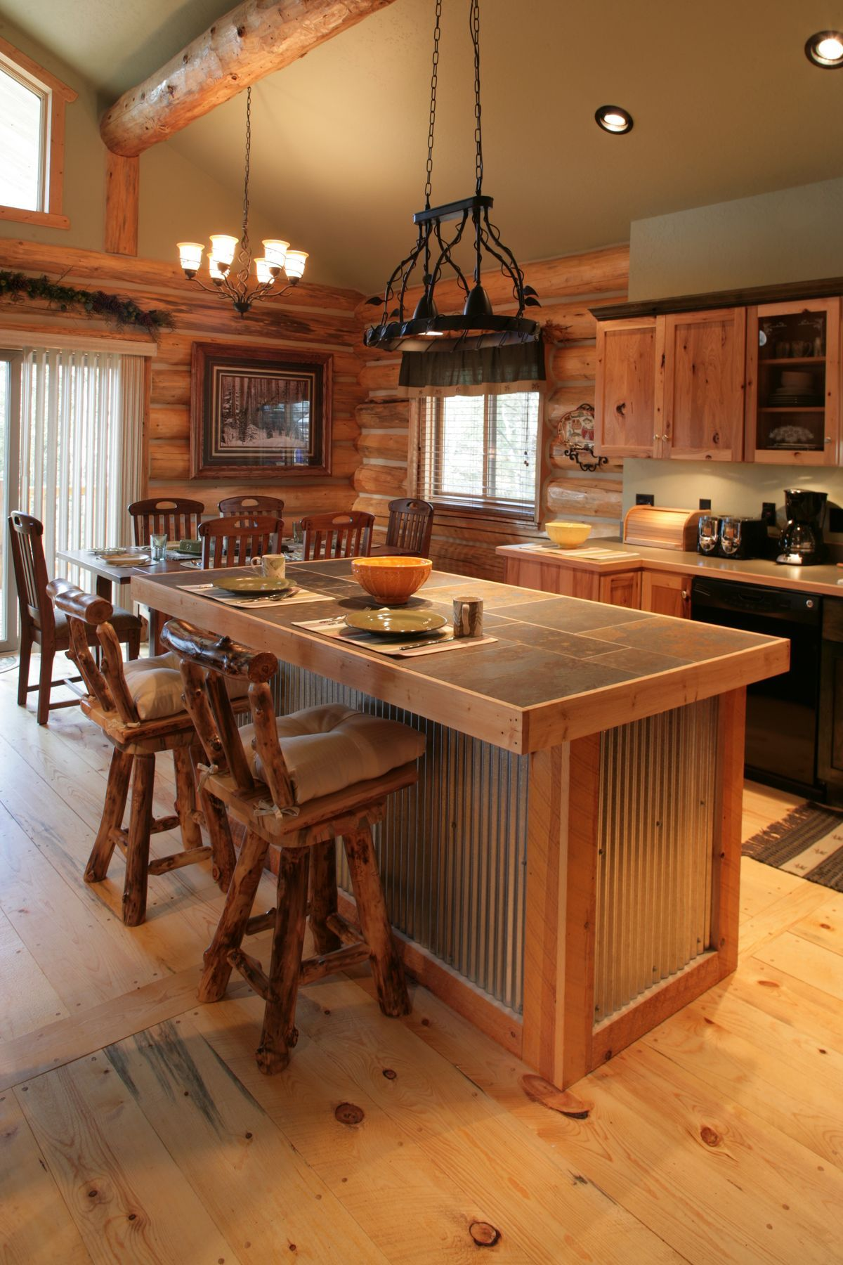 21 Unique Kitchen Island Ideas For Every Space And Budget Homelovers Rustic Kitchen Log Home Builders Cabin Kitchens