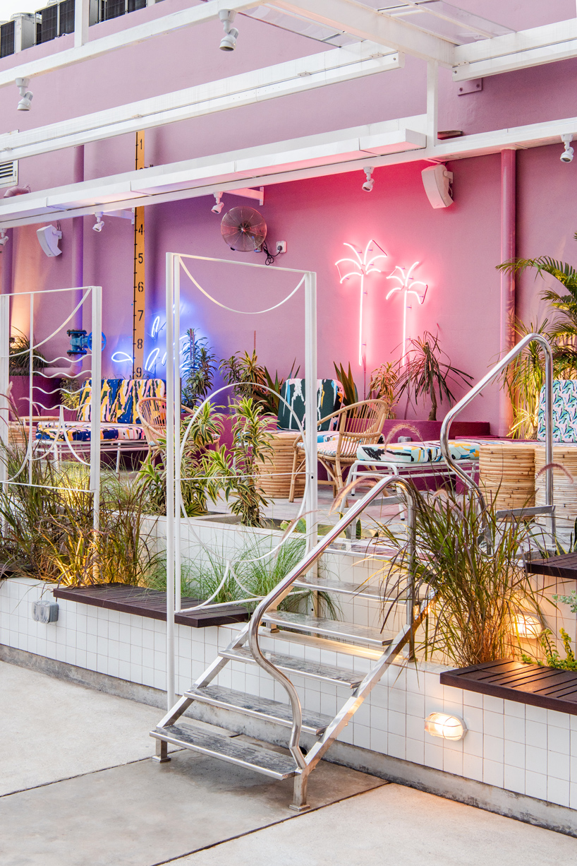POW ideas captures retro neon style for the swimming club in kuala lumpur