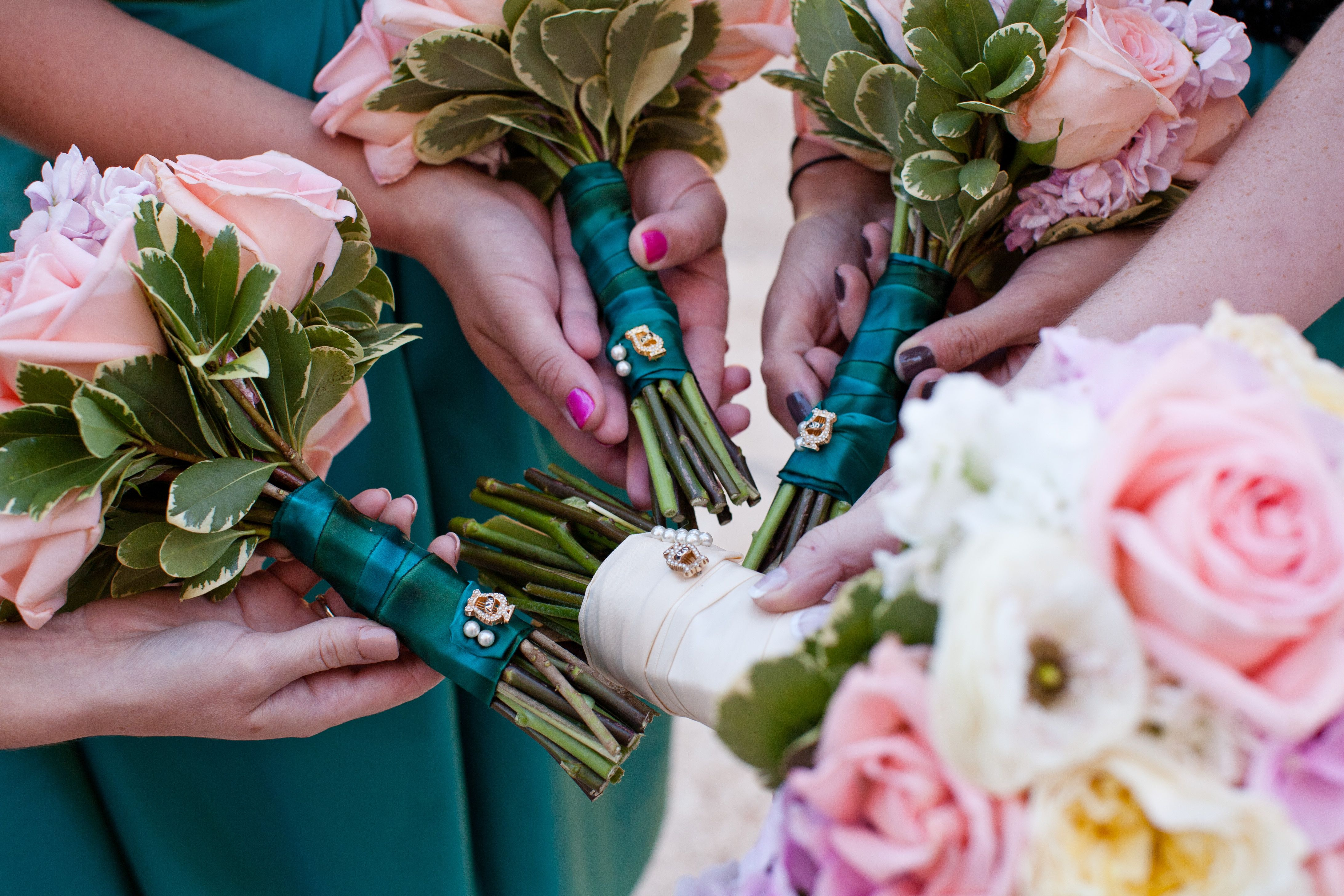 Alpha Chi Omega pins on wedding bouquets...i can see this happening