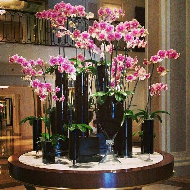 Pin By Helen Olivia On Inspiration Lobby Arrangements Orchid Flower Arrangements Hotel Flower Arrangements Large Flower Arrangements