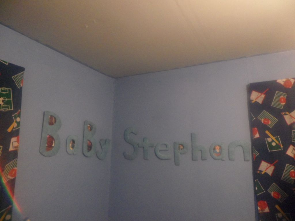 Baby name on wall with pics...so cute