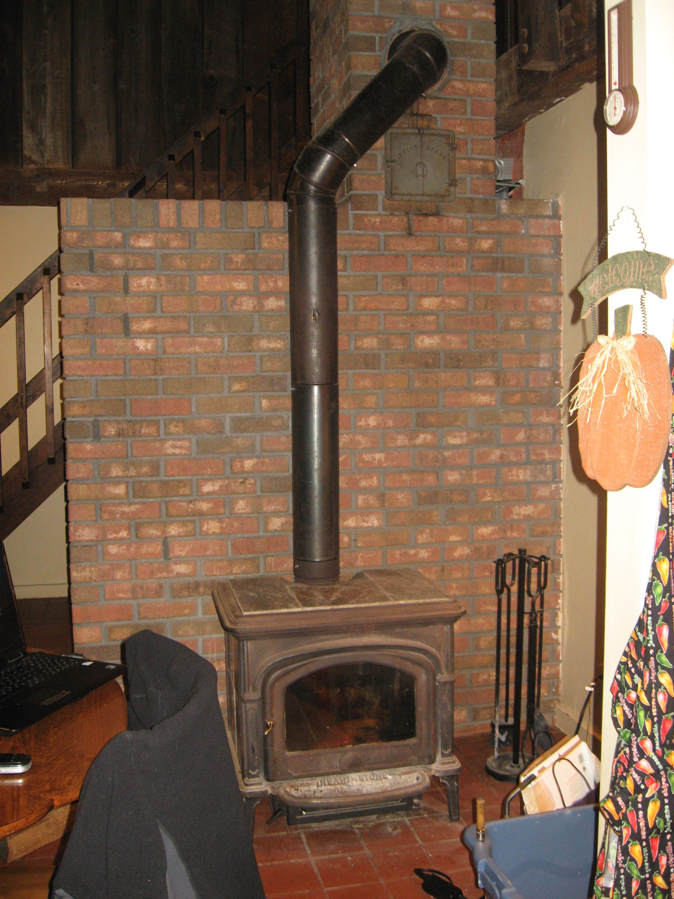 The Russian fireplace behind the woodstove. That whole brick mass heats up and radiates the heat so one hot fire a day heats the house for 12 hours.
