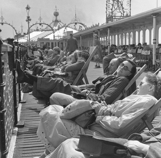 Photo of Sunbathing on the Palace Pier in the 1950s, Brighton, UK.
