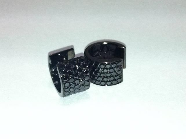Black diamond huggie earrings.