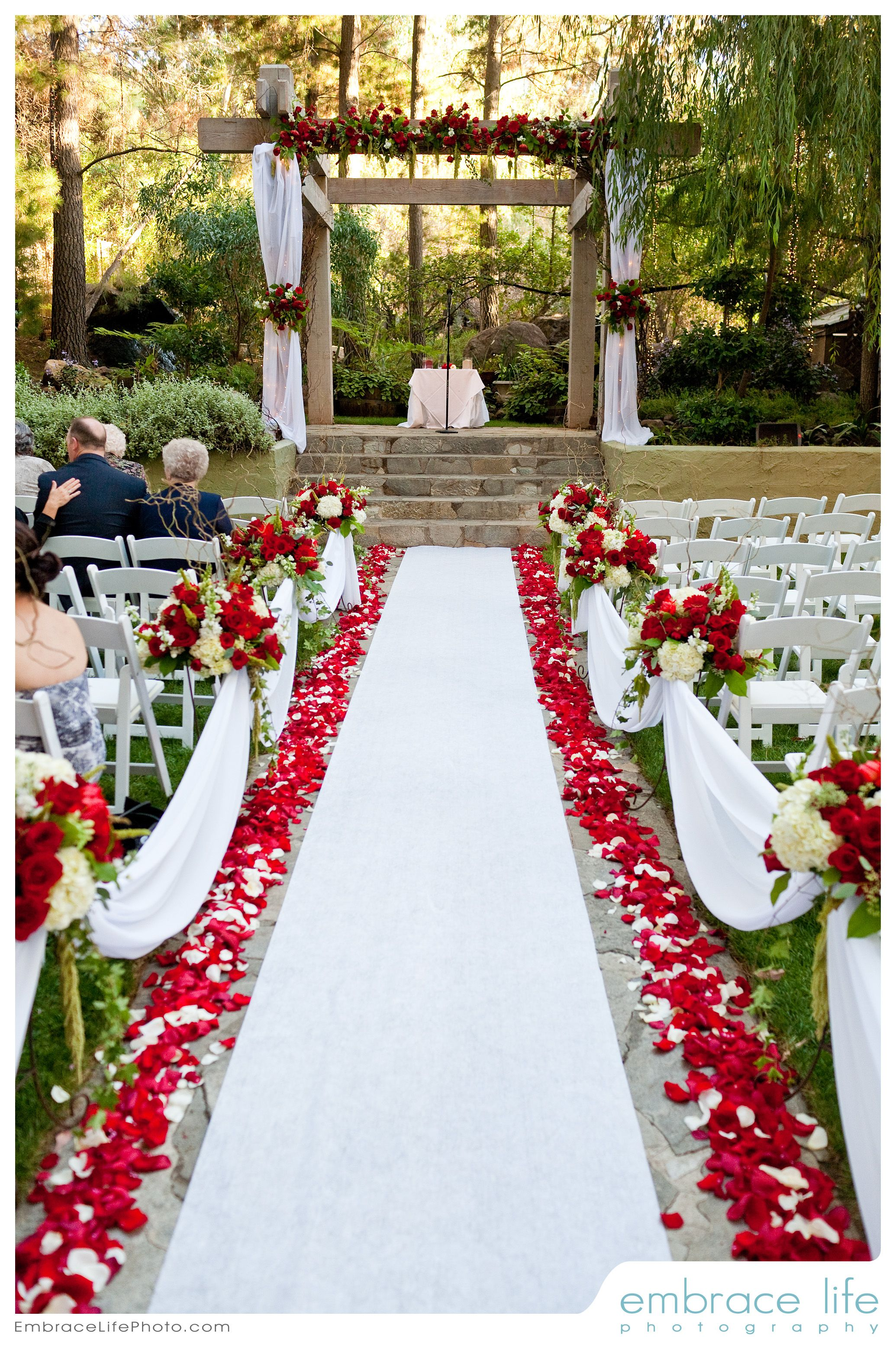 Red and white wedding ceremony flowers by Floral Fields of Burbank