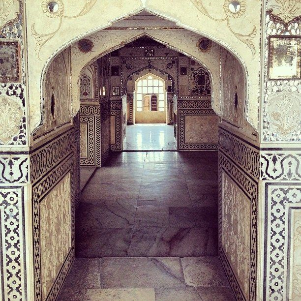 The decorative walls of the Amber Fort in Jaipur.