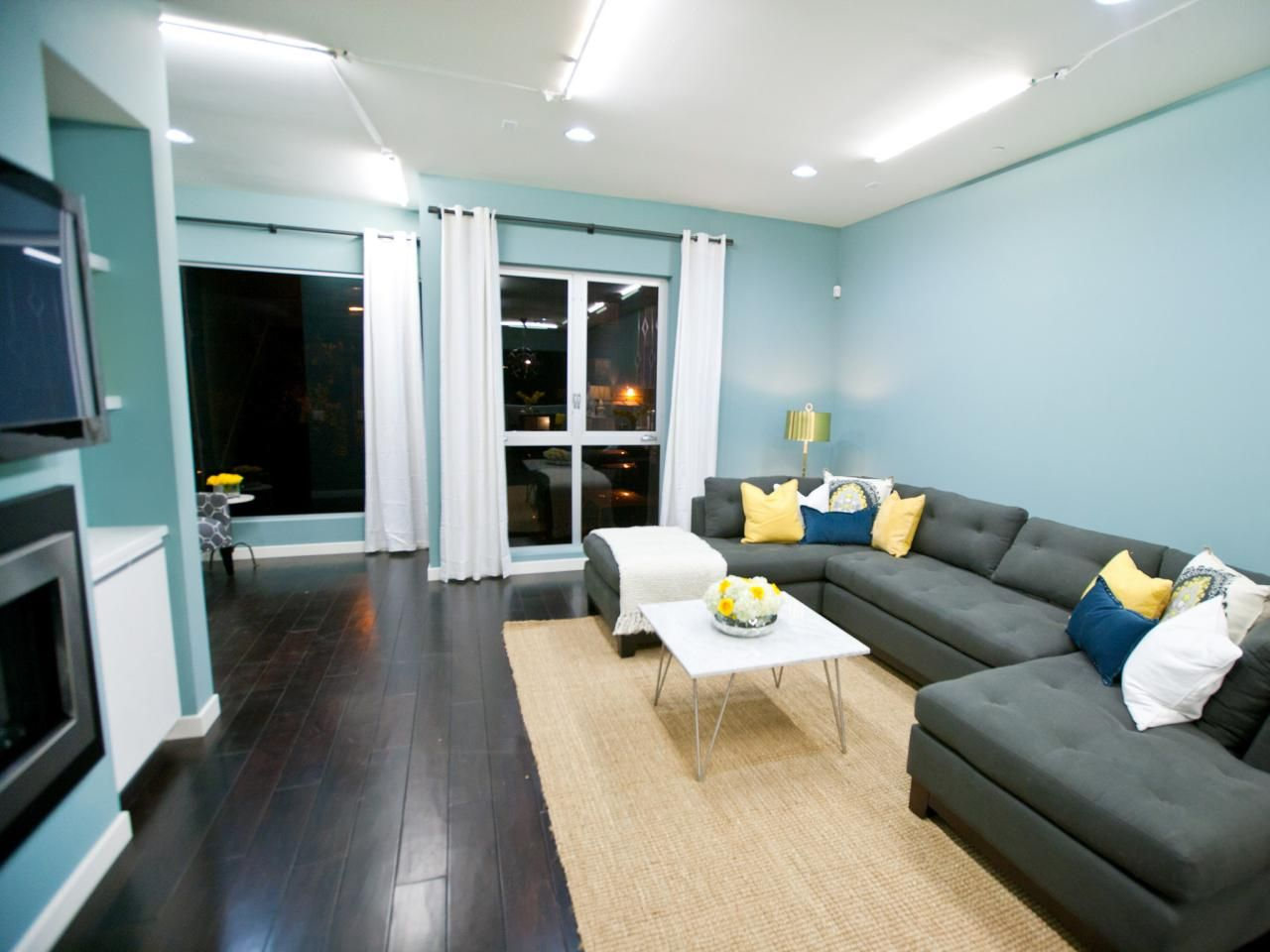 Modern Living Room With Blue Walls Wood Floor Black Lights Living Room Dark Hardwood Floors Living Room Living Room Hardwood Floors