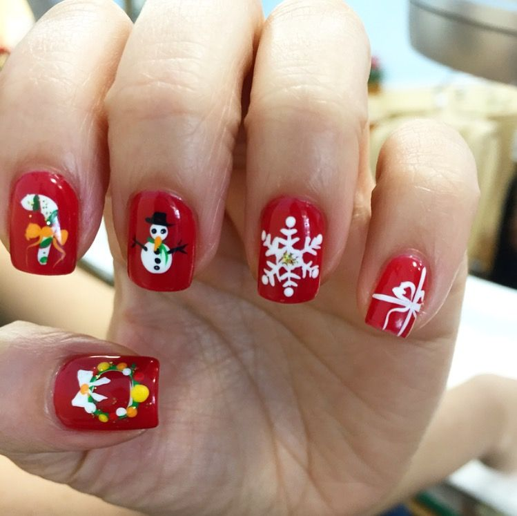 Classy yet festive nails for the holidays! What says Christmas more than a wreath, candy cane, snowman, snowflake, and presents?!