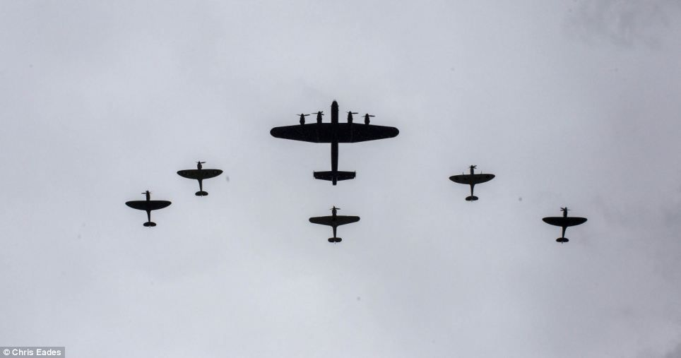 History in the making: This Lancaster bomber and five Spitfires look like a scene from the past but flew over the Palace today to mark the Queen's 60-year reign