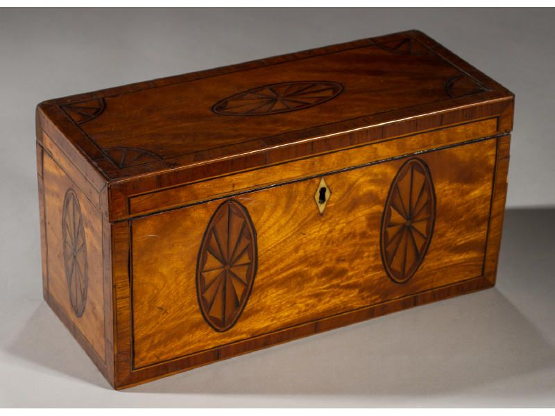 English 19C Satinwood Inlaid Tea Caddy. The rectangular satin wood tea caddy has inlaid oval fans and string inlay. The interior lid is also inlaid. In good condition. Measures 5.7 inches high, 11.1 inches wide and 4.7 inches deep. #MyersFineArt #Antiques #Art