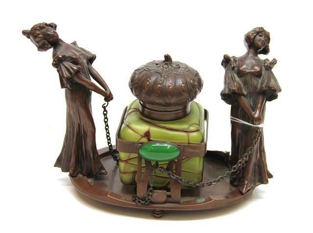 An Austrian Patinated Bronze and Green Iridescent Art Glass Figural Inkstand