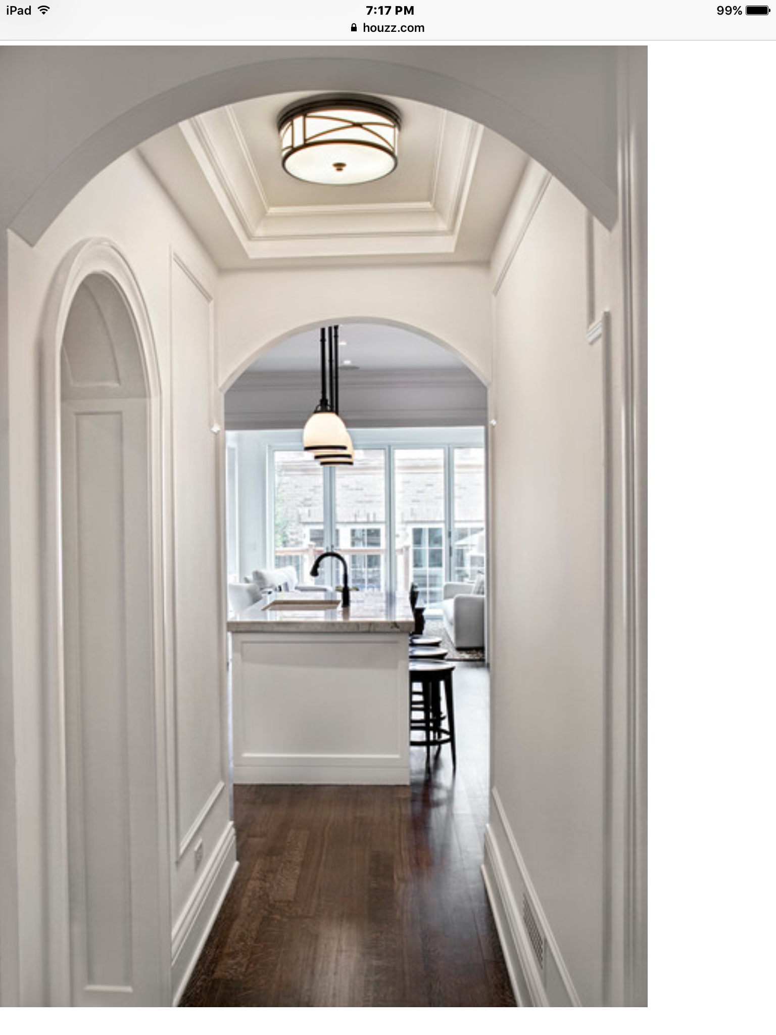 Wood trim on walls in hallways....nice touch! Small
