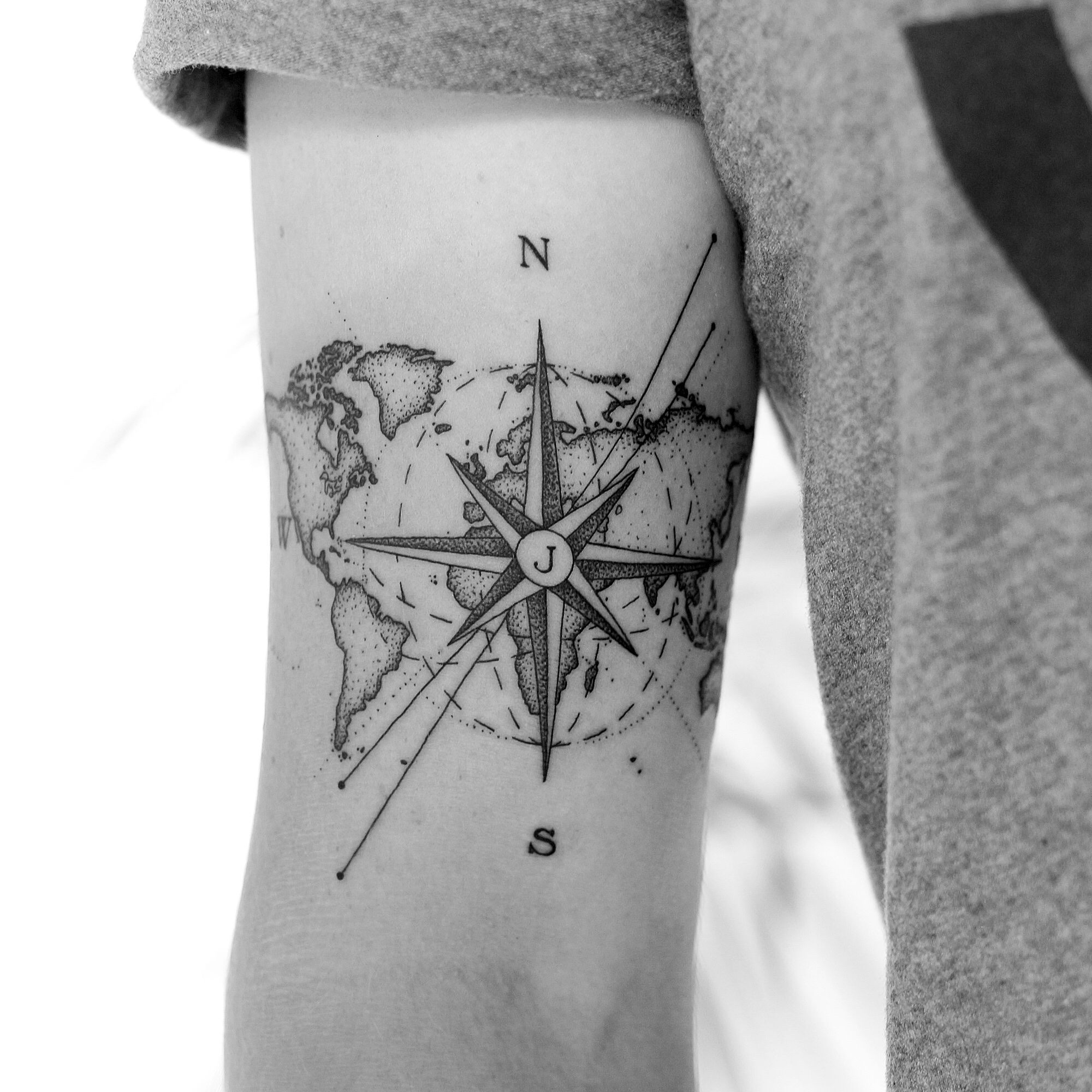 Photo of Dominik theWHO Tattoo compass map of the world