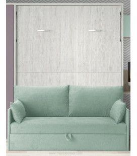 Modelo de cama abatible vertical de matrimonio con un sofá con arcón delante.