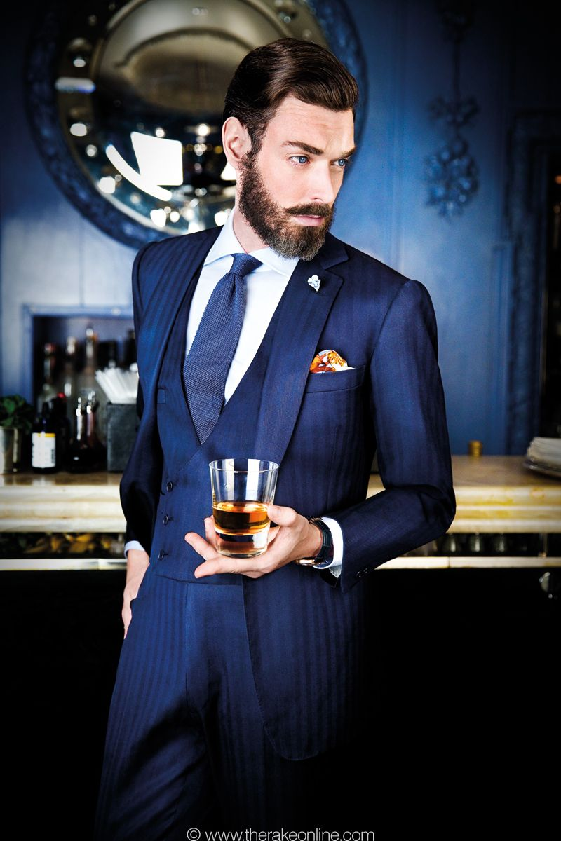 A thinly pinstriped navy suit is a must just like manners and