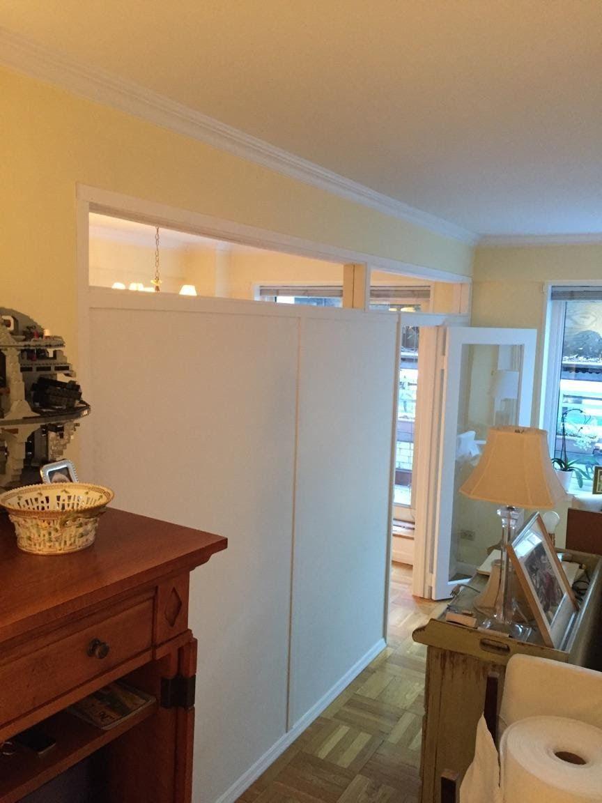 Custom temporary wall with plexiglass top and single light doors