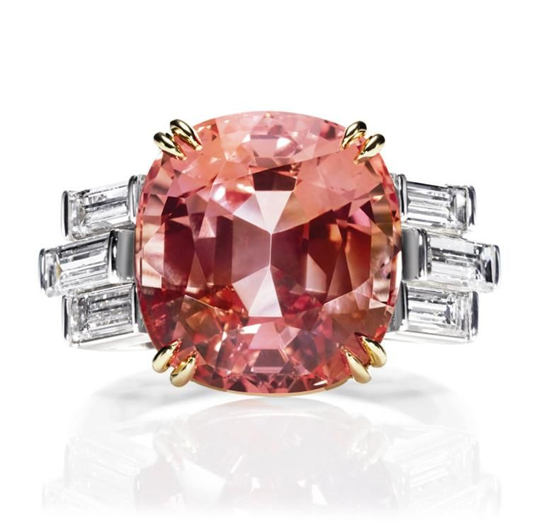 Sunset by Harry Winston, Padparadscha Sapphire and Diamond Ring. Cushion-cut padparadscha sapphire, 12.44 carats; 6 baguette diamonds, 1.24 total carats; 18K yellow gold and platinum settings.