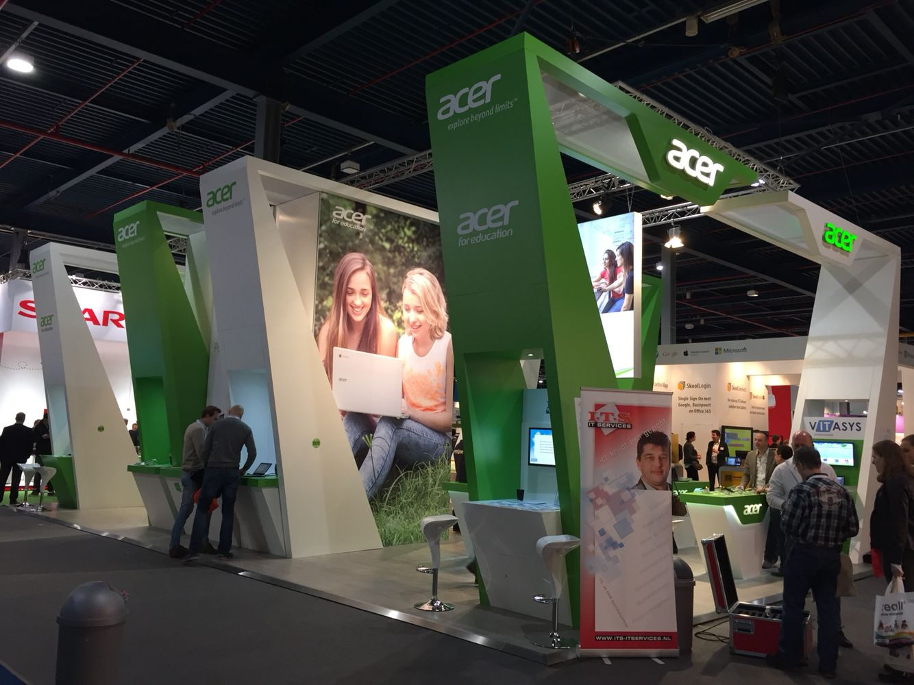 Exhibition Stand Floor : The use of lines and levels help this booth stand out on