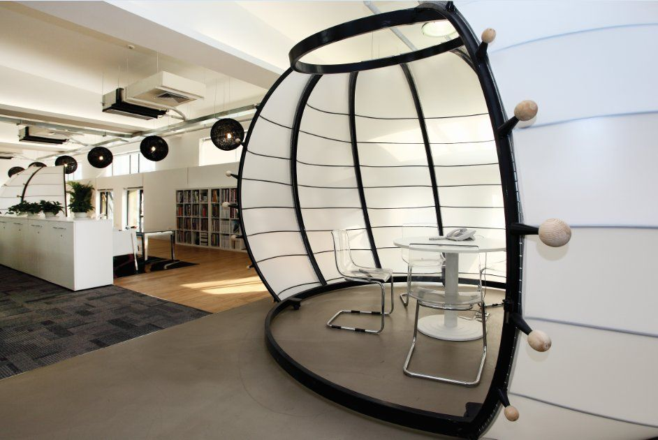 We love the sleek look and clean feel to this office meeting pod ...