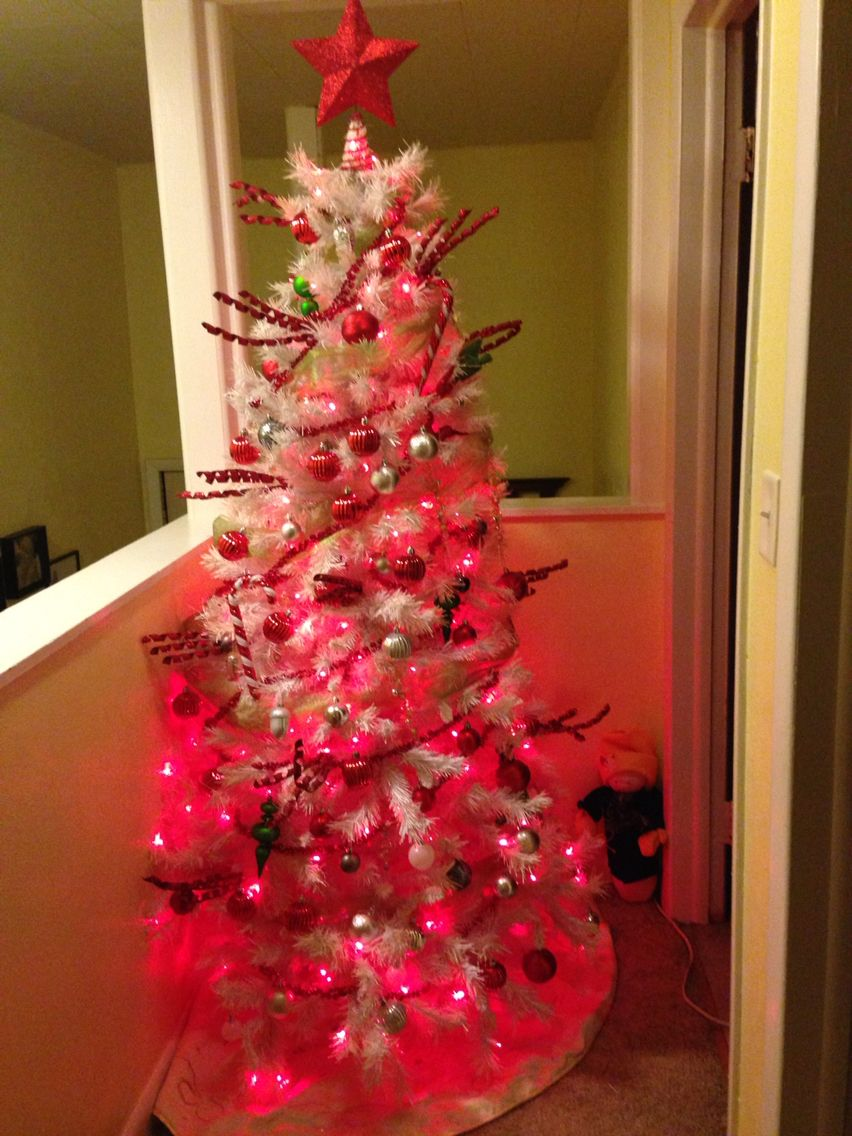 Red Silver And Green Decorations On A White Tree With Lights
