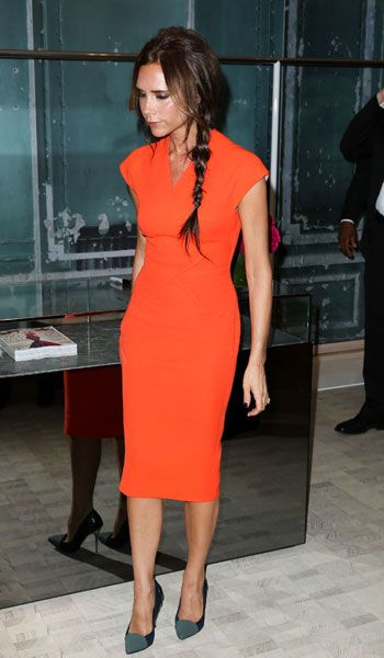 Victoria Beckham in orange Victoria Beckham dress