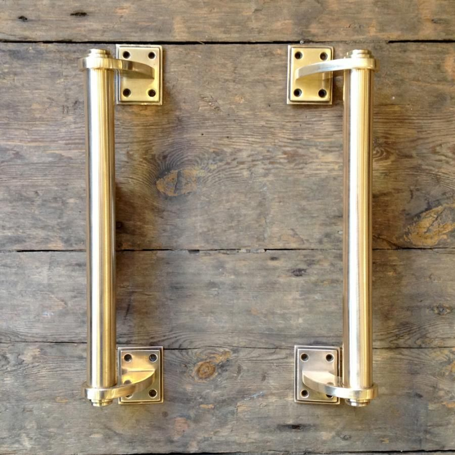A beautiful pair of original Art Deco door pull handles in solid brass.  Previously for - A Beautiful Pair Of Original Art Deco Door Pull Handles In Solid