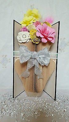Vase of flowers in a book. Book fold book art custom made handmade flowers