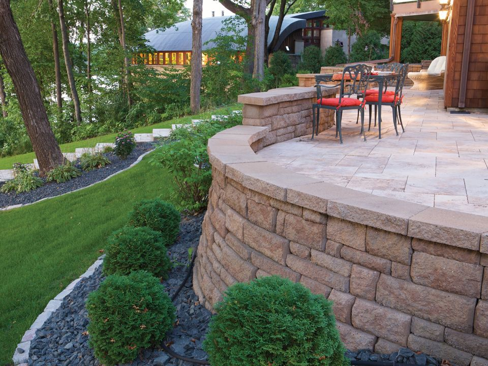The Bayfield Wall System Comes In Different Heights Making It Perfect To Create A Seat Wall On Your Raised Patio Sloped Backyard Sloped Garden Retaining Wall