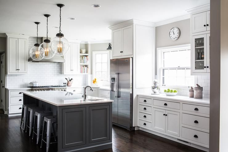 gray kitchen island illuminated by large glass globe pendants his wonderfully 1326