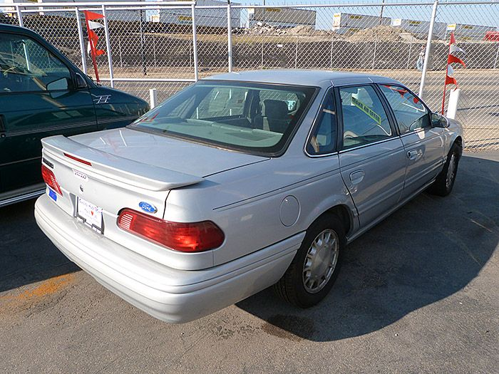 Here's a 1995 Ford Taurus GL that I have.  It has 77,000 miles.  Let me know what you think.