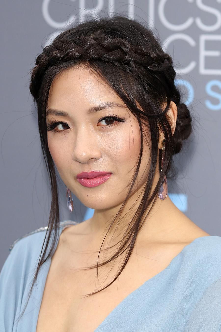 Constance Wu nailed the Grecian goddess look with her braid crowd, glossy pink lip color, and long, fluttery lashes. | Best Hair & Makeup Looks at the 2016 Critics Choice Awards
