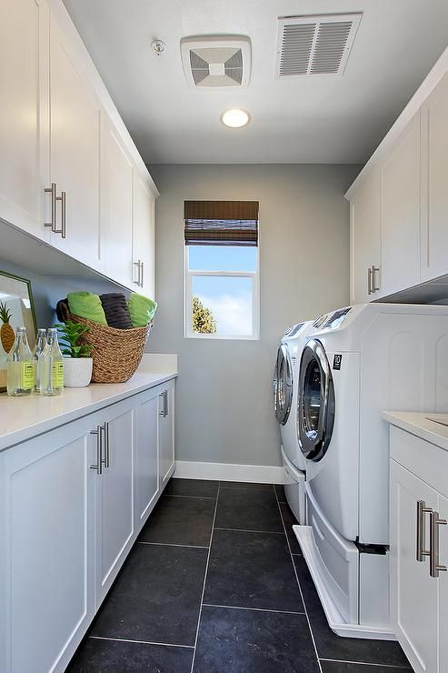 Contemporary Long Laundry Room Features Crisp White Shaker Cabinets Paired  With White Quartz Countertops Facing Under Cabinets Washer And Dryer Atop  Black ...