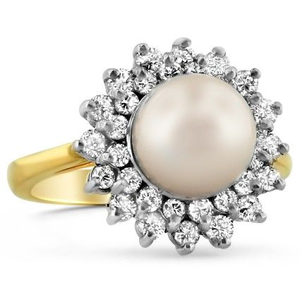 A sunburst halo of scintillating diamond accents blooms around an elevated cultured pearl