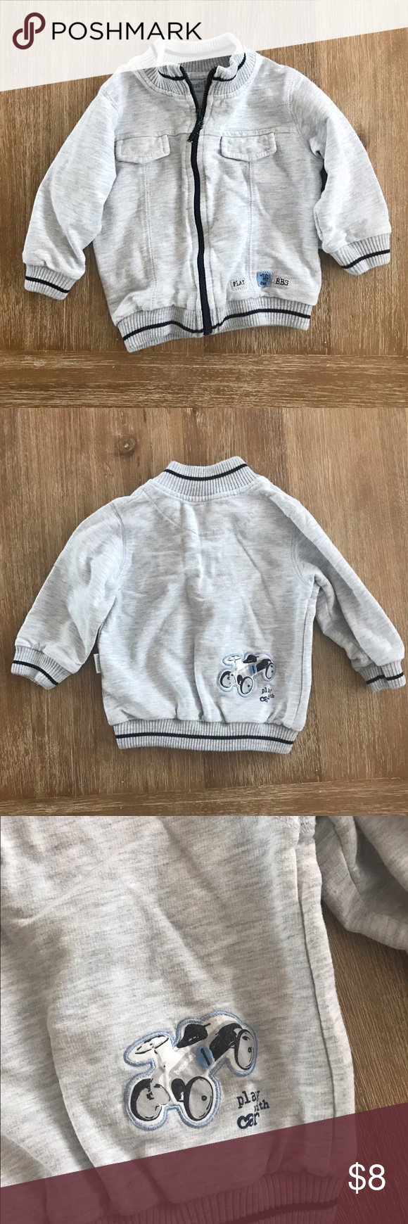 BOYS Bebessi Grey Sweatshirt Jacket 12 Months BOYS longsleeve grey light jacket zipper closure. Navy blue accent. Car on back. 12 months. Bebessi. OFFERS WELCOME | BUNDLE FOR DISCOUNT | MORE ITEMS COMING Bebessi Shirts & Tops