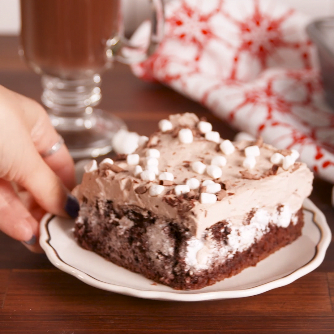 Hot Cocoa Poke Cake Winter blues, who? Get the recipe at .